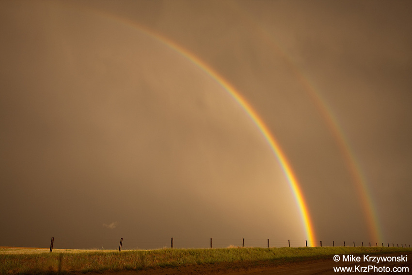 Double rainbow over a golden field in Oakley, KS