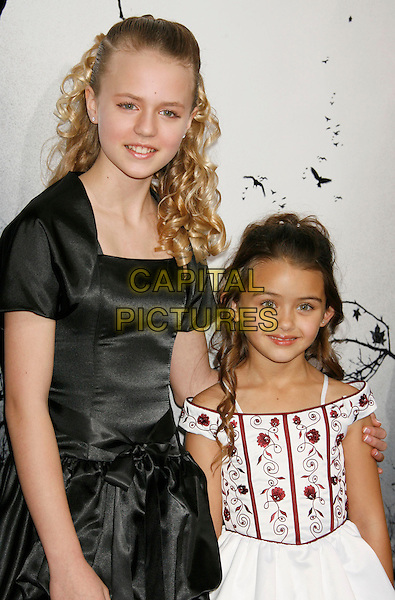 """COURTNEY TAYLOR BURNESS & SHYANNE McCLURE.""""Premonition"""" World Premiere held at the ArcLight Cinerama Dome Theatre, Hollywood, California, USA..March 12th, 2007.half length black satin dress white pattern red .CAP/ADM/RE.©Russ Elliot/AdMedia/Capital Pictures"""