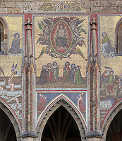 Christ in glory surrounded by angels and 6 Czech saints below, with heaven on the left and hell on the right; The Last Judgment Mosaic on the Golden Portal or zlata brana of St Vitus Cathedral, between the tower and the South transept, through which kings entered the cathedral for coronation, St Vitus cathedral, a Gothic Roman catholic cathedral founded 1344, within Prague Castle, Prague, Czech Republic. The 84 square metre mosaic was completed in 1371 at the request of Charles IV, king of Bohemia and Holy Roman Emperor. The cathedral's full name is the St Vitus, St Wenceslas and St Adalbert cathedral and is the largest church in the Czech Republic. The historic centre of Prague was declared a UNESCO World Heritage Site in 1992. Picture by Manuel Cohen