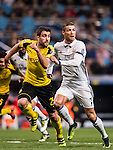 Cristiano Ronaldo (r) of Real Madrid fights for the ball with Sokratis Papastathopoulos of Borussia Dortmund during the 2016-17 UEFA Champions League match between Real Madrid and Borussia Dortmund at the Santiago Bernabeu Stadium on 07 December 2016 in Madrid, Spain. Photo by Diego Gonzalez Souto / Power Sport Images