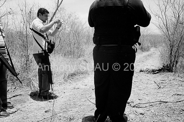 Culiacan, Mexico.June 13, 2007..A drug related execution, adding to the more then 300 this year in Cuilacan. Barely a skeleton remains from an obvious execution on the outskirts of the city. Forensic police established that it was a man of around 50 years of age.