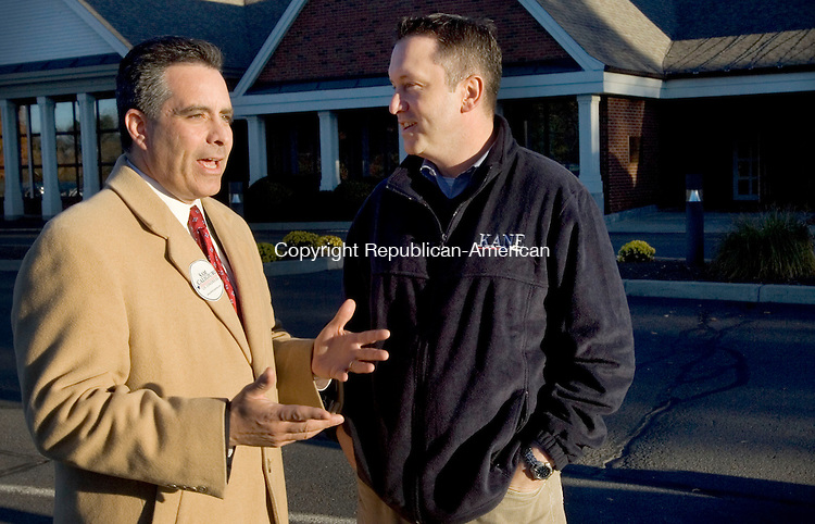 SOUTHBURY, CT. 02 November 2010-110210SV01--Sam S. F. Caligiuri Republican candidate for the 5th district talks with State Senator Rob Kane, R 32nd while campaigning at the Sacred Heart church in Southbury Tuesday.<br /> Steven Valenti Republican-American