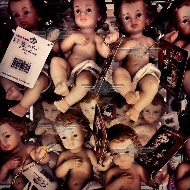 Doll figures representing a baby Jesus are sold for Christmas in Santa Maria, a supermarket in Tumbaco.