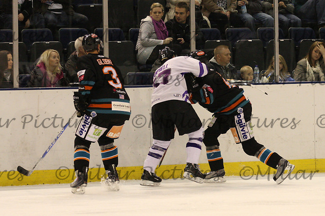 Ryan Campbell in a tussle as Rob Globke looks on