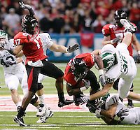 Texas Tech's Baron Batch, center, is brought down by MSU's Kevin Pickelman, right, and Marcus Hyde, lower right, after colliding with teammate Detron Lewis during the first half of the Valero Alamo Bowl, Saturday, Jan. 2, 2010, at the Alamodome in San Antonio. (Darren Abate/pressphotointl.com)