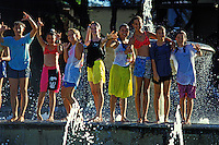 EDITORIAL ONLY. Teenage girls playing in fountain at Kapiolani Park, Waikiki, Oahu