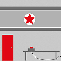 Red button on table below North Korean flag