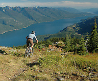 Mountain biking above Kootenay Lake at Kaslo, BC.