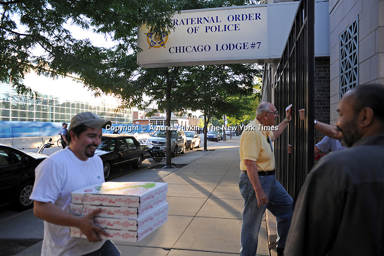 A pizza man delivers a dozen or so pizzas to the 1968 Riot Cops Reunion at the Fraternal Order of Police headquarters, the first such reunion of its kind, 41 years after the 1968 Democratic National Convention, in Chicago, Illinois on June 26, 2009.