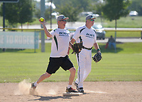 NWA Democrat-Gazette/BEN GOFF @NWABENGOFF<br /> Robert Radford (left), of the Boyd Metals team from Fort Smith throws to first for a double play as teammate Michael Taylor looks on Thursday, July 13, 2017, during the Men's 65+ Major Division game against Dr. Vinyl in the Senior Softball U.S.A. Midwest Championships at the Rogers Regional Sports Park.