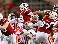 Ohio State Buckeyes defensive lineman Nick Bosa (97) tries to take down Nebraska Cornhuskers quarterback Tanner Lee (13) during the 1st quarter at Memorial Stadium in Lincoln, Neb on October 14, 2017.  [Kyle Robertson/Dispatch]