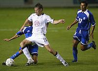 Brian McBride takes on an El Salvador defender in San Salvador, El Salvador, Saturday Oct. 9, 2004. USA won 2-0.