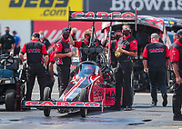 Jul 12, 2020; Clermont, Indiana, USA; Crew members for NHRA top fuel driver Steve Torrence during the E3 Spark Plugs Nationals at Lucas Oil Raceway. This is the first race back for NHRA since the start of the COVID-19 global pandemic. Mandatory Credit: Mark J. Rebilas-USA TODAY Sports