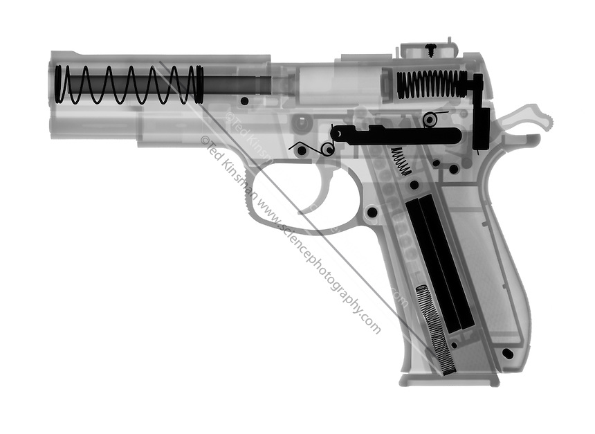 An X-ray of an air gun.  This gun shoots plastic pellets by air pressure.  The gun is designed to be the same weight and size as a real hand gun.