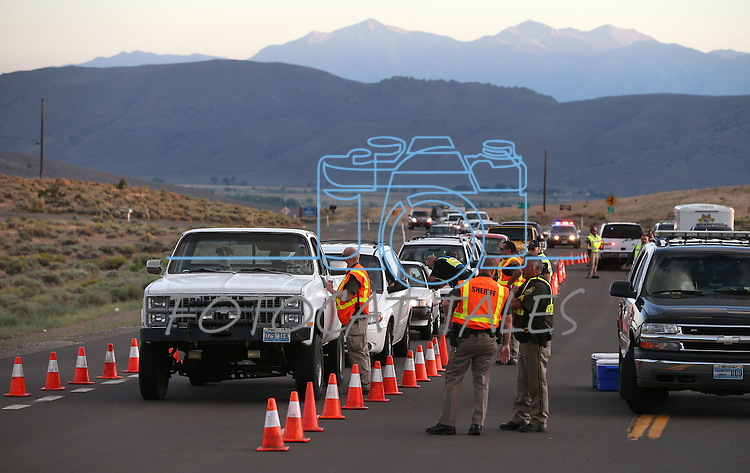 The Carson City Sheriff's Office and the Nevada Highway Patrol conduct a DUI checkpoint in east Carson City, Nev., on Friday, Aug. 8, 2013. <br /> Photo by Cathleen Allison