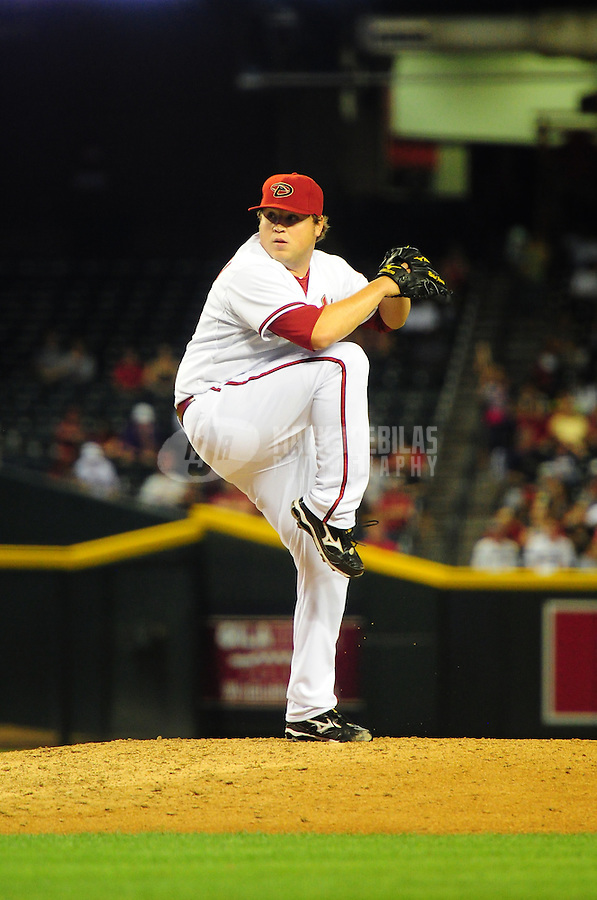 May 8, 2012; Phoenix, AZ, USA; Arizona Diamondbacks pitcher Mike Zagurski winds up during the game against the St. Louis Cardinals at Chase Field. Mandatory Credit: Mark J. Rebilas-.