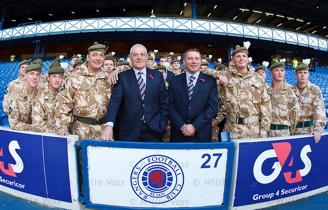Walter Smith and Ally McCoist with soldiers from the Royal Regiment of Scotland at Ibrox today