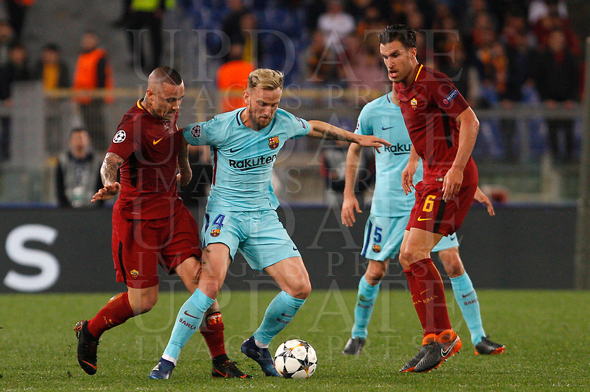 FC Barcelona Ivan Rakitic, center, is challenged by Roma s Radja Nainggolan, left, and Kevin Strootman during the Uefa Champions League quarter final second leg football match between AS Roma and FC Barcelona at Rome's Olympic stadium, April 10, 2018.<br /> UPDATE IMAGES PRESS/Riccardo De Luca