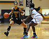 Taylor Goode #2 of St. Anthony's, left, looks to get past Janier Cooper #5 of Monsignor Scanlan during the CHSAA varsity girls basketball Class AA state final at St. John Villa Academy in Staten Island, NY on Saturday, Mar. 12, 2016. Goode scored a team-high 15 points as St. Anthony's won by a score of 57-43.