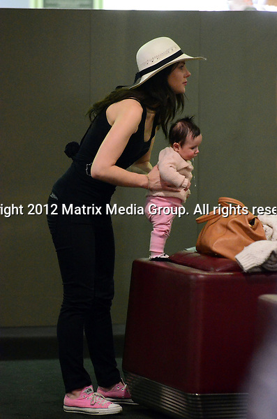 27.08.2012 SYDNEY AUSTRALIA..EXCLUSIVE PICTURES..Jessica Marais and fiance James Stewart with baby Scout arrive at Sydney International Airport for their flight to the USA. Jessica and James happily posed with Scout for their final picture in Australia...*No internet without clearance*.MUST CALL PRIOR TO USE ..+61 2 9211-1088.Matrix Media Group.Note: All editorial images subject to the following: For editorial use only. Additional clearance required for commercial, wireless, internet or promotional use.Images may not be altered or modified. Matrix Media Group makes no representations or warranties regarding names, trademarks or logos appearing in the images.