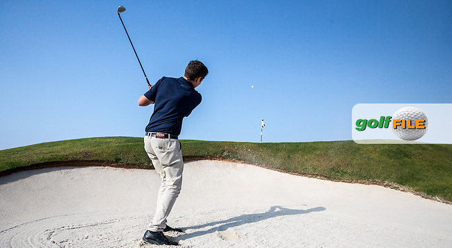 Play from the 12th left-side bunker  at Al Zorah Golf Club, Dubai, United Arab Emirates.  26/01/2016. Picture: Golffile | David Lloyd<br /> <br /> All photos usage must carry mandatory copyright credit (&copy; Golffile | David Lloyd)