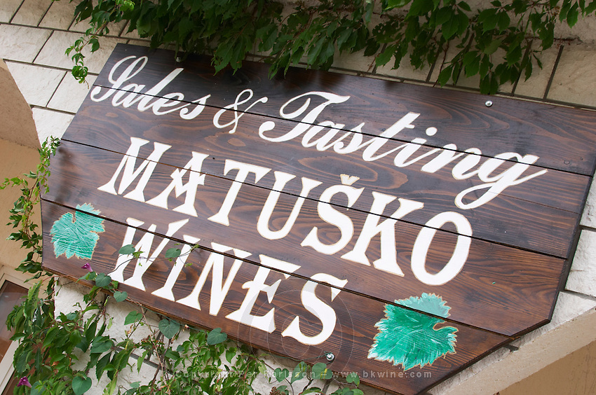 Sign outside the winery saying Sales & Tasting. Matusko Winery. Potmje village, Dingac wine region, Peljesac peninsula. Matusko Winery. Dingac village and region. Peljesac peninsula. Dalmatian Coast, Croatia, Europe.