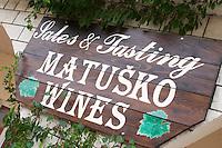 Sign outside the winery saying Sales & Tasting. Matusko Winery. Potmje village, Dingac wine region, Peljesac peninsula. Matusko Winery. Dingac village and region. Peljesac peninsula. Dalmatian Coast, Croatia, Europe.