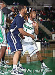 North Texas Mean Green guard Dominique Johnson (1) drives around Jackson State Tigers guard Phillip Williams (21)  in the game between the Jackson State Tigers and the University of North Texas Mean Green at the North Texas Coliseum,the Super Pit, in Denton, Texas. UNT defeated Jackson 68 to 49