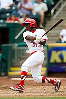 D'Marcus Ingram (31) of the Springfield Cardinals follows through his swing during a game against the Tulsa Drillers at Hammons Field on June 27, 2011 in Springfield, Missouri. (David Welker / Four Seam Images)