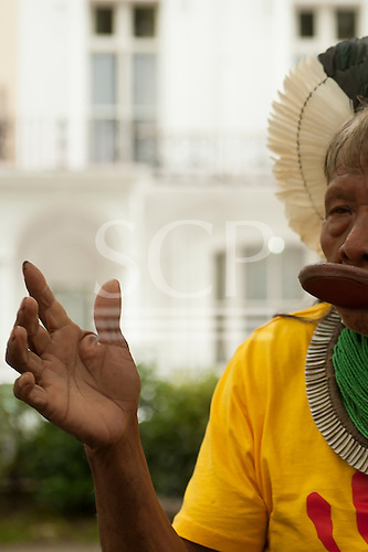 9 June 2014. Kayapo Chief Raoni Metuktire during his visit to London. The chief gesticulates with his hand while talking in a London garden square.
