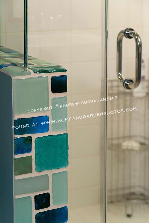 Blue and green recycled glass tiles offer an eye-catching contrast to the white tiles in this newly-remodeled bathroom. This image is available through an alternate architectural stock image agency, Collinstock located here: http://www.collinstock.com