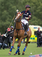Apichet Srivaddhanaprabha (King Power) after he hits the winning goal during the Cartier Queens Cup Final match between King Power Foxes and Dubai Polo Team at the Guards Polo Club, Smith's Lawn, Windsor, England on 14 June 2015. Photo by Andy Rowland.