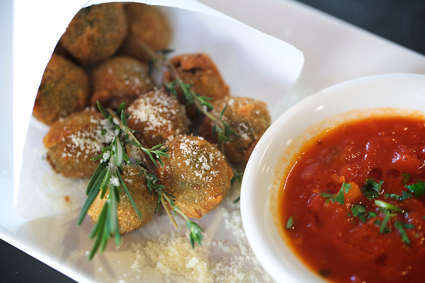 Jersey City, NJ - April 27, 2016: Olive All'Ascolana, prosciutto-mortadella stuffed Castelvetrano olives, breaded, fried and served with spicy marinara at Pasta dal Cuore, a pasta-focused Italian restaurant in Jersey City.<br /> <br /> CREDIT: Clay Williams for Gothamist<br /> <br /> &copy; Clay Williams / claywilliamsphoto.com