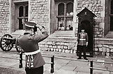 ENGLAND London, an off duty British Royal Guard takes a photograph of a British Royal Guard at the forecourt of Buckingham Palace (B&W)