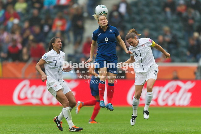 MOENCHENGLADBACH, GERMANY - JULY 13:  Eugenie Le Sommer of France (C) heads the ball against United States players Shannon Boxx (L) and Christie Rampone (R) during a FIFA Women's World Cup semifinal match at Stadion im Borussia Park on July 13, 2011  in Moenchengladbach, Germany.  Editorial use only.  Commercial use prohibited.  No push to mobile device usage.  (Photograph by Jonathan P. Larsen)