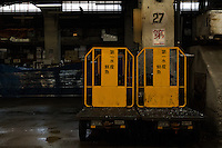 Tractors parked after business hours in Tsukiji Wholesale Fish Market, Tsukiji, Tokyo, Japan. Friday March 3rd 2017