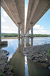 The Pennsylvania Turnpike stretches over the Susquehanna River, where a small creek meets the river In Middletown Pennsylvania.