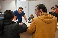 """Die """"Zentrale Aufnahmeeinrichtung des Landes Berlin fuer Asylbewerber"""" (ZAA) des Berliner Landesamt fuer Gesundheit und Soziales (LaGeSo) in der Turmstrasse 21 in Berlin-Moabit. Hier werden alle in Berlin ankommenden Fluechtlinge registriert und bekommen eine Erstversorgung. In dieser Erstaufnahmestelle werden sie auf die vom Land bereitgestellten Unterkuenfte verteilt.<br /> Im Bild: Mitarbeiter der Aufnahmeeinrichtung bearbeiten den Fall von serbischsprachigen Fluechtlingen.<br /> 24.9.2014, Berlin<br /> Copyright: Christian-Ditsch.de<br /> [Inhaltsveraendernde Manipulation des Fotos nur nach ausdruecklicher Genehmigung des Fotografen. Vereinbarungen ueber Abtretung von Persoenlichkeitsrechten/Model Release der abgebildeten Person/Personen liegen nicht vor. NO MODEL RELEASE! Don't publish without copyright Christian-Ditsch.de, Veroeffentlichung nur mit Fotografennennung, sowie gegen Honorar, MwSt. und Beleg. Konto: I N G - D i B a, IBAN DE58500105175400192269, BIC INGDDEFFXXX, Kontakt: post@christian-ditsch.de<br /> Urhebervermerk wird gemaess Paragraph 13 UHG verlangt.]"""