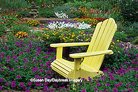 63821-14204 Yellow Adirondack chair in flower garden Marion Co., IL