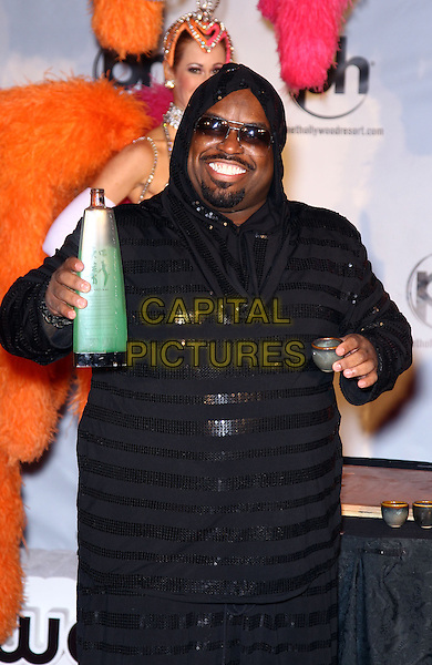 """Cee Lo Green (Thomas DeCarlo Callaway).CeeLo Green's official arrival for his new show """"CeeLo Green Is Loberace"""" at Planet Hollywood Resort and Casino, Las Vegas, NV., USA..February 26th, 2013.half length black hooded top sequins sequined stripe jumpsuit sunglasses shades goatee facial hair green bottle cup drink beverage .CAP/ADM/MJT.© MJT/AdMedia/Capital Pictures."""