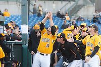 A long standing tradiotion at Eck Stadium a life long WSU fan throws candy to the team after each run during the NCAA matchup between the Wichita State Shockers and North Dakota Fighting Sioux at Eck Stadium on February 26th, 2012 in Wichita, Kansas.  The Shockers defeated UND 16-1.  (William Purnell/Four Seam Images)