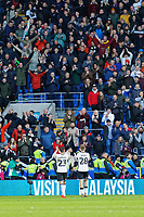 (L-R) Connor Roberts and George Byers of Swansea City applaud Swansea supporters during the Sky Bet Championship match between Cardiff City and Swansea City at the Cardiff City Stadium, Cardiff, Wales, UK. Sunday 12 January 2020