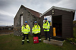 Roz Jewell, Colm McNicholl  and Ross Moodie (left), part of the HM Coastguard service during a training drill on the the Inner Hebridean island of Colonsay on Scotland's west coast.  The island is in the council area of Argyll and Bute and has an area of 4,074 hectares (15.7 sq mi). Aligned on a south-west to north-east axis, it measures 8 miles (13 km) in length and reaches 3 miles (4.8 km) at its widest point, in 2019 it had a permanent population of 136 adults and children.