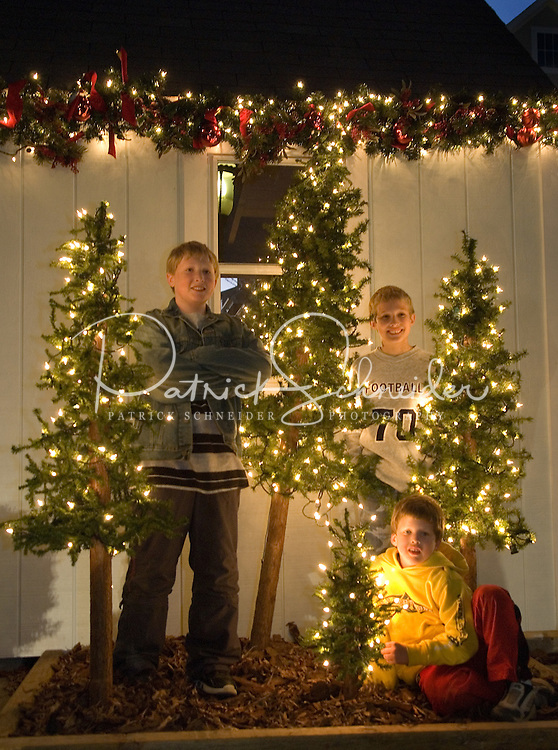 Three boys have their photos taken during the annual Christmas tree lighting event at Birkdale Village in Huntersville, NC. Birkdale Village combines the best of shopping, dining, apartments and entertainment venues within a 52-acre mixed-use development.