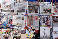 Spanish language newspapers, tabloids and magazines at a newstand in Mexico City