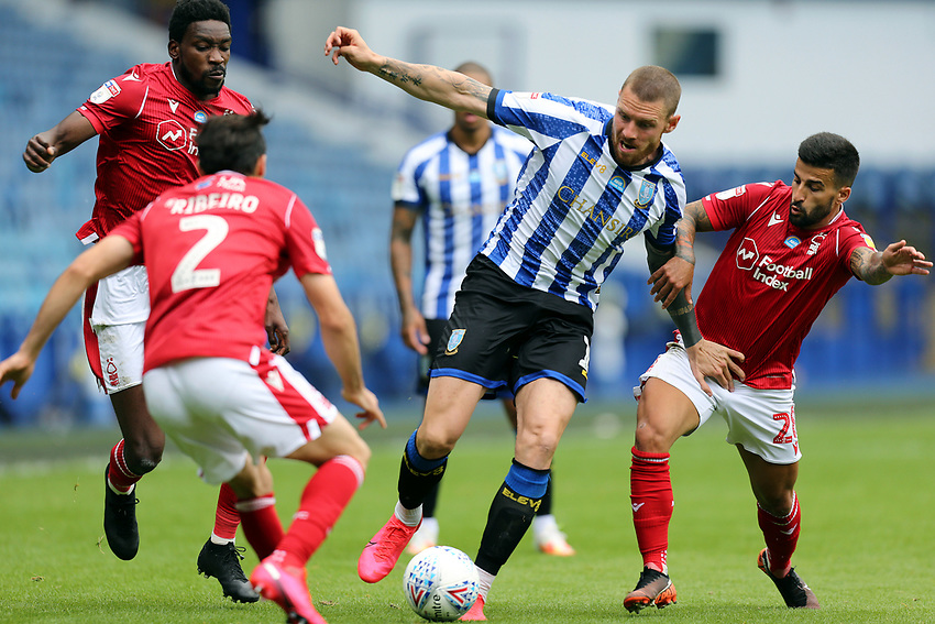Sheffield Wednesday's Connor Wickham under pressure from Nottingham Forest's Yuri Ribeiro (left) and Tiago Silva<br /> <br /> Photographer Rich Linley/CameraSport<br /> <br /> The EFL Sky Bet Championship - Sheffield Wednesday v Nottingham Forest - Saturday 20th June 2020 - Hillsborough - Sheffield <br /> <br /> World Copyright © 2020 CameraSport. All rights reserved. 43 Linden Ave. Countesthorpe. Leicester. England. LE8 5PG - Tel: +44 (0) 116 277 4147 - admin@camerasport.com - www.camerasport.com