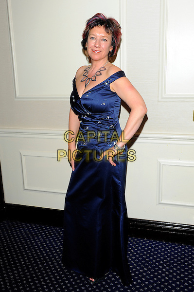 Jane Wenham Jones.Romantic Novel of the Year Awards, the Royal Air Force Club, The Presidents Room, 128 Piccadilly, London, England..February 26th, 2013.full length blue silk satin dress hands on hips necklace .CAP/CJ.©Chris Joseph/Capital Pictures.