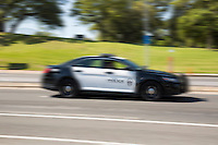 An APD police car, responds to a 911 emergency call in Austin, Texas; image with blurred motion.<br />