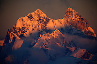 Russia; Caucasus. Ushba mountain (4710 m asl) just on the Georgian side of the border; seen from Elbrus by sunset.