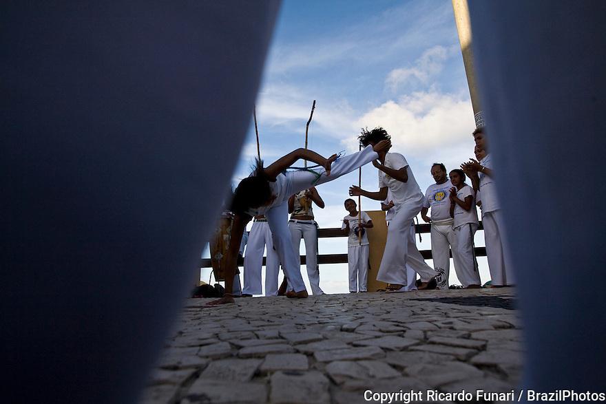 Roda de Capoeira, Young couple practicing capoeira at Ponta Negra beach, Natal city, Rio Grande do Norte State, Brazil. Afro-brazilian cultural traditions, mix of fight and dance.